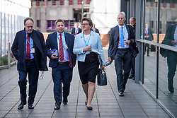© Licensed to London News Pictures. 03/10/2017. Manchester, UK. DUP leader ARLENE FOSTER (centre) seen arriving on day three of the Conservative Party Conference. The four day event is expected to focus heavily on Brexit, with the British prime minister hoping to dampen rumours of a leadership challenge. Photo credit: Ben Cawthra/LNP