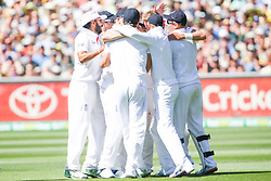 © Licensed to London News Pictures. 27/12/2013. The England team in a huddle after getting a wicket during Day 2 of the Ashes Boxing Day Test Match between Australia Vs England at the MCG on 27 December, 2013 in Melbourne, Australia. Photo credit : Asanka Brendon Ratnayake/LNP