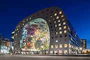 Lateral elevation of curved building. Market Hall Rotterdam, Rotterdam, Netherlands. Architect: MVRDV, 2014.