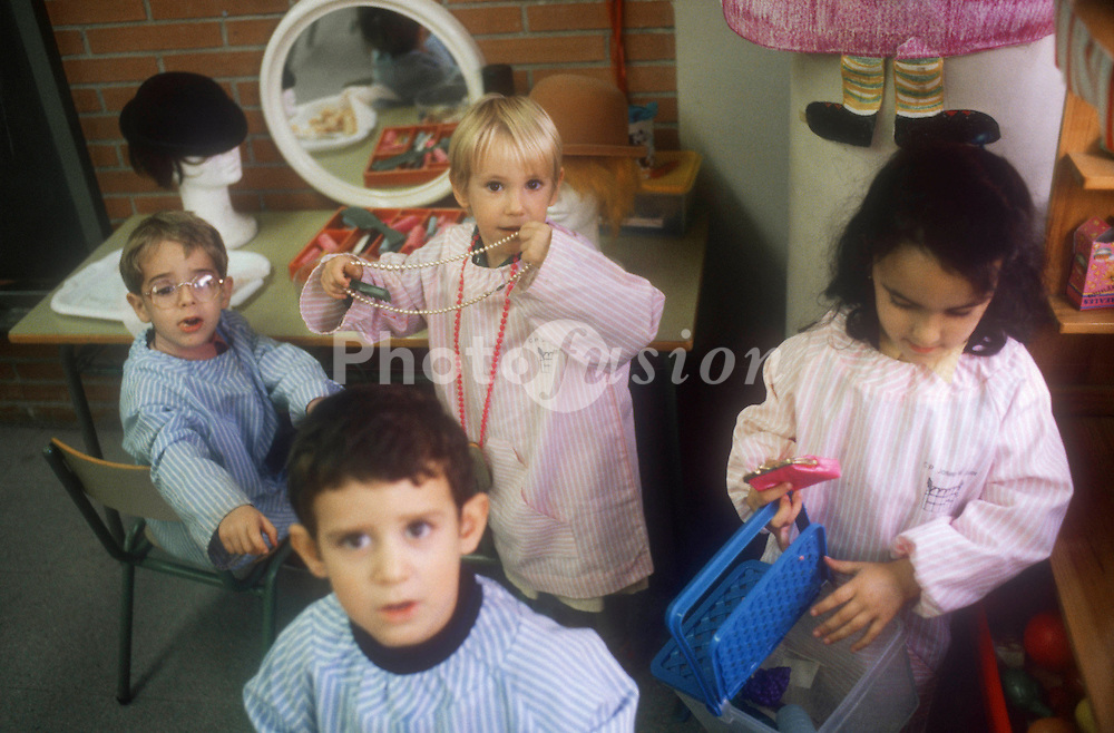 Group of nursery school children playing in classroom,