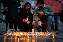 © Licensed to London News Pictures. 28/03/2016. London, UK. Candles are lit in London's Trafalgar Square as part of a vigil for the victims of  the Easter Sunday suicide bombing in a busy public park in Lahore, Pakistan. A faction of the Pakistani Taliban, Jamaat-ul-Ahrar, has claimed responsibility for the attack which killed at least 70 people and wounding more than 300.  Photo credit : Rob Pinney/LNP