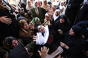 A Palestinian woman mourns with hundreds of other women in the Palestinian town of Beit Hanoun after a Palestinian militant was killed by Israeli troops June 3,2006. Israeli special forces entered early this morning into the area.(Photo by Heidi Levine/Sipa Press).