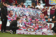 """Aston Villa fans display a pained banner showing past players in support of """"Kick it out"""" during the EFL Sky Bet Championship match between Aston Villa and Blackburn Rovers at Villa Park, Birmingham, England on 30 March 2019."""