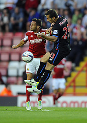 Bristol City's Sam Baldock battles for the high ball with Crystal Palace's Florian Marange  - Photo mandatory by-line: Joe Meredith/JMP - Tel: Mobile: 07966 386802 27/08/2013 - SPORT - FOOTBALL - Ashton Gate - Bristol - Bristol City V Crystal Palace -  Capital One Cup - Round 2