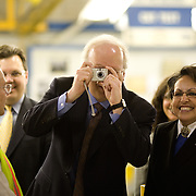 Deputy Chief of Staff Karl Rove photographs photographers as President Bush tours the Ford Motor Company -- Kansas City Assembly Plant Tuesday, March 20, 2007, in Kansas City, MO.  Tour guides are Mayor Jim Stoufer; Alan Mulally, President and CEO of Ford Motor Company; Ken Ward, Plant Manager. <br /> <br /> Photo by Khue Bui