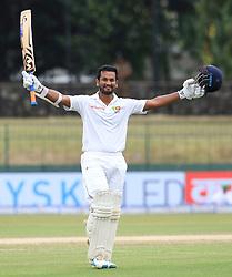 August 6, 2017 - Colombo, Sri Lanka - Sri Lankan cricketer Dimuth Karunaratne celebrates after scoring a century (100 runs) during the 4th Day's play in the 2nd Test match between Sri Lanka and India at the SSC international cricket stadium at the capital city of Colombo, Sri Lanka on Sunday 6 August 2017. (Credit Image: © Tharaka Basnayaka/NurPhoto via ZUMA Press)