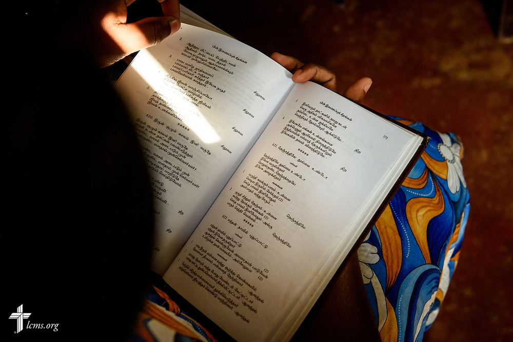 A church member uses a Tamil hymnal as the Rev. P. Gnanakumar leads worship on the Eila rubber plantation in the Sabaragamuwa Province of Sri Lanka on Saturday, January 20, 2018. LCMS Communications/ Erik M. Lunsford