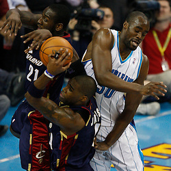 Mar 24, 2010; New Orleans, LA, USA; Cleveland Cavaliers forward Antawn Jamison (4), forward J.J. Hickson (21) and New Orleans Hornets center Emeka Okafor (50) jump for a rebound during the second half at the New Orleans Arena. The Cavaliers defeated the Hornets 105-92. Mandatory Credit: Derick E. Hingle-US PRESSWIRE