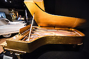 Museum display of the gold grand piano owned by Elvis Presley on display at the Country Music Hall of Fame in Nashville, TN.