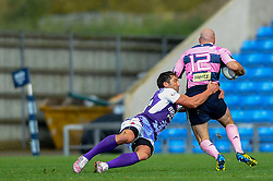 London Welsh Fly-Half (#10) Gavin Henson tackles Stade Francais Inside Centre (#12) Felipe Contepomi in the second half - Photo mandatory by-line: Rogan Thomson/JMP - Tel: Mobile: 07966 386802 13/10/2012 - SPORT - RUGBY - Kassam Stadium - Oxford. London Welsh v Stade Francais - European Challenge Cup
