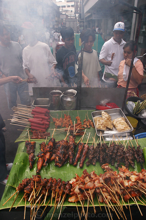 Pig and chicken intestines, pig blood, and fatty pork are common beloved street foods in Manila, Philippines. Isaw (pig and chicken small-intestine barbecue) is a national favorite, as is taba (pieces of pork fat skewered onto a stick and deep-fried). Dugo is curdled and congealed pig blood, cut into chunks, skewered, and then grilled. Cow blood is too strong tasting to use, say the street vendors. Adidas, named after the running shoe, is barbecued chicken feet. (From a photographic gallery of street food images, in Hungry Planet: What the World Eats, p. 131)