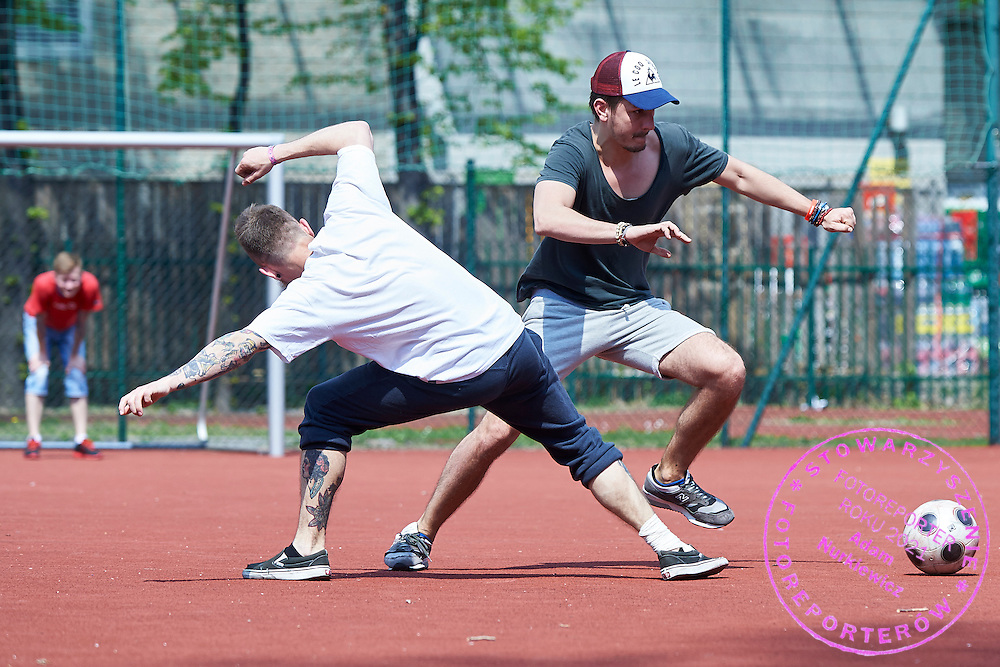 (R) Jakub Szymczuk (Gosc Niedzielny Weekly) fights for the ball with (L) Piotr Smolinski (Polskapresse Agency) during friendly soccer match between Polish photographers at Saska Kepa in Warsaw, Poland.<br /> <br /> Poland, Warsaw, April 25, 2015<br /> <br /> Picture also available in RAW (NEF) or TIFF format on special request.<br /> <br /> For editorial use only. Any commercial or promotional use requires permission.<br /> <br /> Mandatory credit:<br /> Photo by &copy; Adam Nurkiewicz / Mediasport