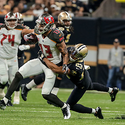 Nov 5, 2017; New Orleans, LA, USA; New Orleans Saints cornerback Marshon Lattimore (23) tackles Tampa Bay Buccaneers wide receiver Mike Evans (13) during the first half of a game at the Mercedes-Benz Superdome. Mandatory Credit: Derick E. Hingle-USA TODAY Sports