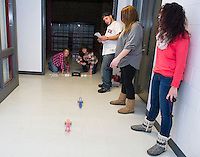 Christina Chioccola and Caroline Maddocks test out their CO2 Drag Racers with  Jacob Olisky, Jill Fitts and Courtney St. Germain from Everyday Science class with Jo-Anne Gilbert at Laconia Academy Monday evening.  (Karen Bobotas/for the Laconia Daily Sun)