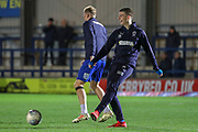 AFC Wimbledon defender Steve Seddon (15) and AFC Wimbledon midfielder Mitchell (Mitch) Pinnock (11) warming up during the EFL Sky Bet League 1 match between AFC Wimbledon and Peterborough United at the Cherry Red Records Stadium, Kingston, England on 12 March 2019.