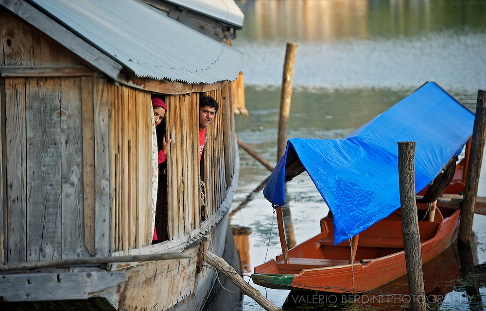 Two dwellers of one of the many houseboats on the Dal Lake in Srinagar. Kashmir. India