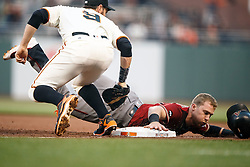 SAN FRANCISCO, CA - APRIL 20: Brandon Drury #27 of the Arizona Diamondbacks is picked off at first base by Brandon Belt #9 of the San Francisco Giants during the first inning at AT&T Park on April 20, 2016 in San Francisco, California.  (Photo by Jason O. Watson/Getty Images) *** Local Caption *** Brandon Drury; Brandon Belt
