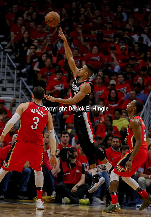 Apr 21, 2018; New Orleans, LA, USA; Portland Trail Blazers guard CJ McCollum (3) shoots over New Orleans Pelicans guard Rajon Rondo (9) and forward Nikola Mirotic (3) during the second quarter in game four of the first round of the 2018 NBA Playoffs at the Smoothie King Center. Mandatory Credit: Derick E. Hingle-USA TODAY Sports