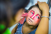 08 FEBRUARY 2013 - BANGKOK, THAILAND:  A child is made up to perform in a Chinese opera for Chinese New Year at Seacon Square in Bangkok. Chinese opera is popular in Thailand and is usually performed in the Teochew language. The weeks surrounding Chinese New Year are important for retailers in Thailand and many malls put on special promotions and events honoring Chinese culture, like Lion Dances or Chinese Opera. Thailand has a large Thai-Chinese population. Millions of Chinese emigrated to Thailand (then Siam) in the 18th and 19th centuries and brought their cultural practices with them.   PHOTO BY JACK KURTZ