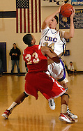 5 FEB. 2010 -- TOWN AND COUNTRY, MO. --  CBC High School's Cris Noll (34, CQ) is guarded by Chaminade Prep's Bradley Beal (23) during the game between CBC and Chaminade at CBC High School in Town and Country, Mo. Friday, Feb. 5, 2010. Photo (c) copyright by Sid Hastings.