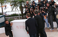 Director Gustave Kervern, Actor Albert Dupontel, Actor Benoît Poelvoorde, Director Benoît Delepine dismantle the podium at Le Grand Soir photocall at the 65th Cannes Film Festival France. Tuesday 22nd May 2012 in Cannes Film Festival, France.