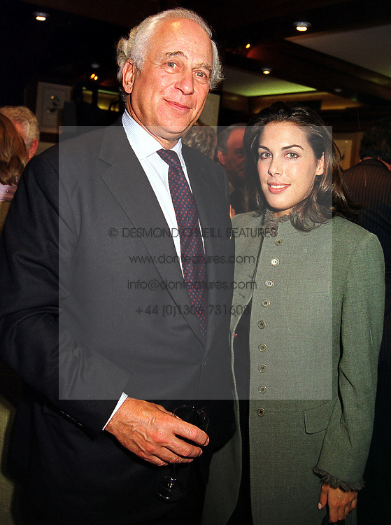 Banker SIR EVELYN DE ROTHSCHILD and his daughter MISS JESSICA DE ROTHSCHILD, at a reception in London on 27th October 1999.MYF 36