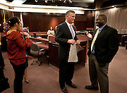 Mayor Peter Corroon, center, speaks with Amadou Niang, a refugee from Mali, from the United Africans of Utah at the Salt Lake County Government Center, Tuesday, Dec. 4, 2012.
