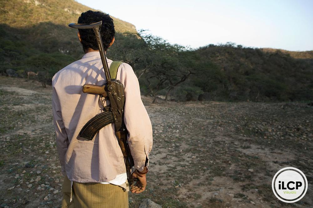 Yemeni man looking for wildlife to hunt, Hawf Protected Area, Yemen