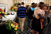 Dozens of classmates cry and hug during the viewing for Cora Delille at Dwayne Spence Funeral Home in Pickerington on May 15, 2014. In her suicide note, Delille, who was 15 years old when she died on May 10, attributed the bullying she endured at school to be a factor in her decision to commit suicide.