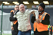A Swindon Town fan invades the pitch and is restrained by stewards during the EFL Sky Bet League 2 match between Milton Keynes Dons and Swindon Town at stadium:mk, Milton Keynes, England on 9 February 2019.