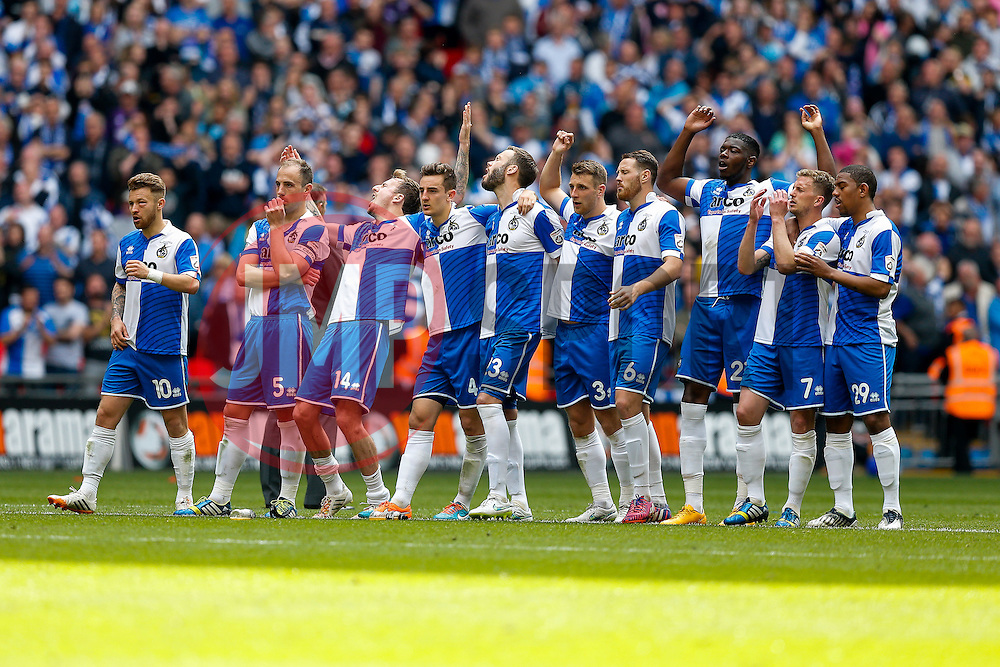Bristol Rovers players react after Grimsby Town score in the penalty shootout - Photo mandatory by-line: Rogan Thomson/JMP - 07966 386802 - 17/05/2015 - SPORT - FOOTBALL - London, England - Wembley Stadium - Bristol Rovers v Frimsby Town - Vanarama Conference Premier Play-off Final.