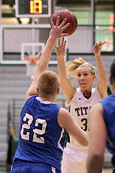 15 January 2014:  Samantha Ellsworth during an NCAA women's division 3 basketball game between the Millikin Big Blue and the Illinois Wesleyan Titans in Shirk Center, Bloomington IL