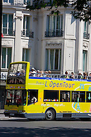 tour bus on boulevard de la madeleine, Paris France in May 2008