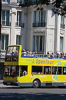 tour bus on boulevard de la madeleine, Paris France in May 2008