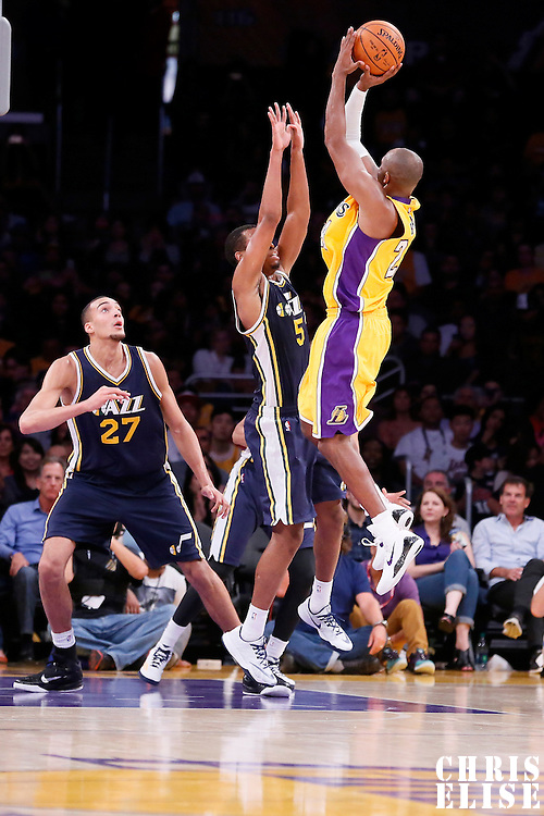 19 October 2014: Los Angeles Lakers guard Kobe Bryant (24) takes a jump shot over Utah Jazz guard Rodney Hood (5) during the Los Angeles Lakers 98-91 victory over the Utah Jazz, in a preseason game, at the Staples Center, Los Angeles, California, USA.