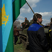KRAMATORSK, UKRAINE - April 16, 2014: Pro-Russia activists, in the eastern city of Kramatorsk, bring to an halt a column of Ukrainian military men and war tanks heading towards the city's airfield, where the National Guard is establishing base for a mega anti-terrorist operation announced by the government in Kiev, in order to regain the control of several locations taken under control by separatist militias.
