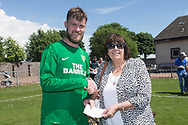 Hilltown Hotspurs captain Liam Peter presentes a cheque to Amanda Kopel of the Frank's Law campaign. The donation comes from fine paid by players in the Dundee Saturday Morning Football League over the season- Riverside CSC (light blue) v Hilltown Hotspurs (green) in the Dundee Saturday Morning Football League Shaun Kelly Memorial Cup Final at North end, Dundee, Photo: David Young<br /> <br />  - &copy; David Young - www.davidyoungphoto.co.uk - email: davidyoungphoto@gmail.com