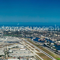 Aerial view of Miami International  Airport viewed from the west with downtown Miami in the distance.