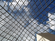 Interior of the 'Louvre Pyramid' at the Louvre museum, Paris France. Designed by I. M. Pei