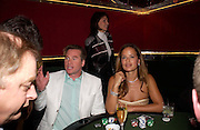 Val Kilmer and Jade Jagger with Victoria Smirnof behind. . PARTYPOKER.COM masterclass hosted by poker author Tony Holden. Ultra Lounge, Selfridges. 11 May 2005. ONE TIME USE ONLY - DO NOT ARCHIVE  © Copyright Photograph by Dafydd Jones 66 Stockwell Park Rd. London SW9 0DA Tel 020 7733 0108 www.dafjones.com