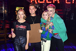 Rafferty Law (second from left) Anais Gallagher (second from right) and Gabriel-Kane Day Lewis (right) during the Tommy Hilfiger Front row during London Fashion Week SS18 held at Roundhouse, Chalk Farm Rd, London. Picture Date: Tuesday 19 September. Photo credit should read: Ian West/PA Wire
