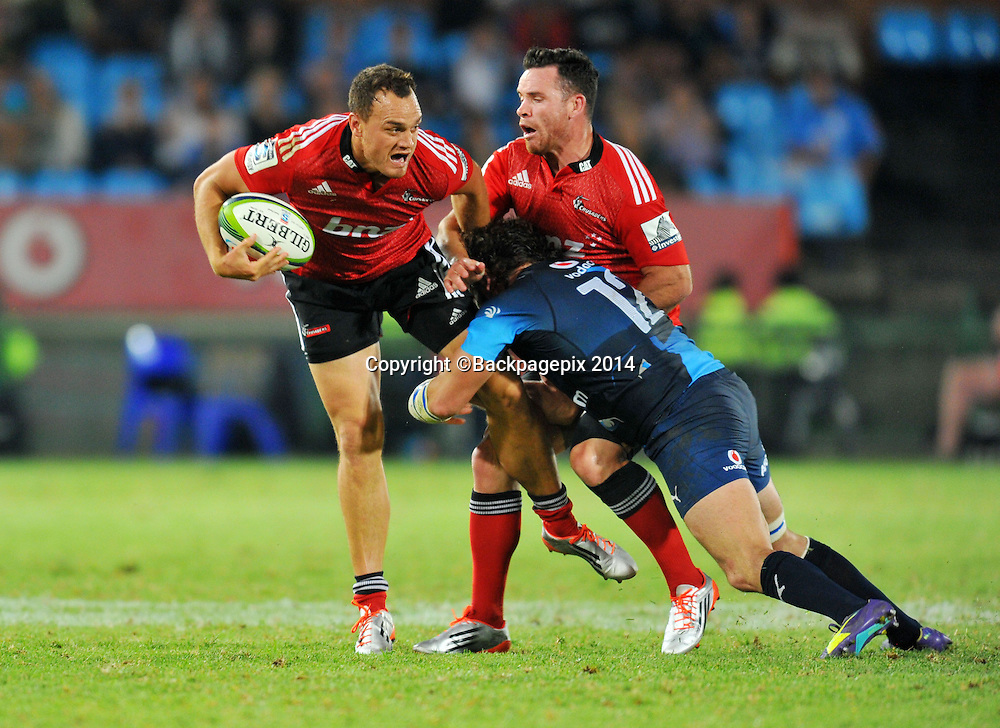 Israel Dagg of the Crusaders tackled by Tom Taylor of the Bulls during the 2015 Super Rugby rugby match between the Bulls and the Crusaders at the Loftus Versfeld Stadium in Pretoria, South Africa on March 28, 2015 ©Samuel Shivambu/BackpagePix
