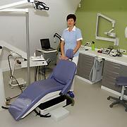 Ans Bakker Mondhygiene Catthenhagestraat 26 Naarden.ruimte, tandarts, praktijk, stoel, wit, groen, inrichting, uniform, gezondheidszorg,
