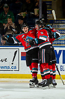 KELOWNA, BC - NOVEMBER 6: Michael Farren #16, Mark Liwiski #9 and Alex Swetlikoff #17 of the Kelowna Rockets celebrate a second period goal against the Victoria Royals at Prospera Place on November 6, 2019 in Kelowna, Canada. (Photo by Marissa Baecker/Shoot the Breeze)