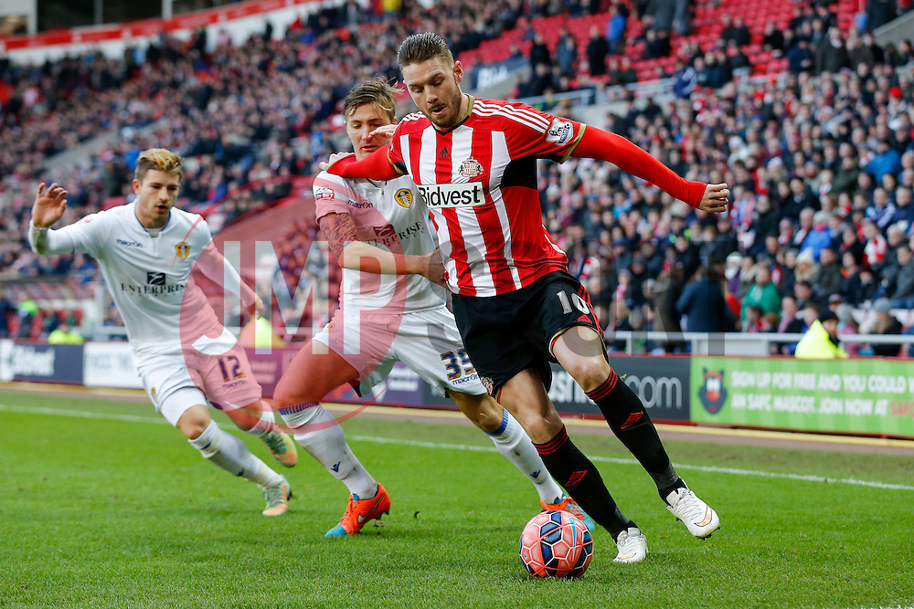 Connor Wickham of Sunderland is challenged by Dario del Fabro of Leeds United - Photo mandatory by-line: Rogan Thomson/JMP - 07966 386802 - 04/01/2015 - SPORT - FOOTBALL - Sunderland, England - Stadium of Light - Sunderland v Leeds United - FA Cup Third Round Proper.