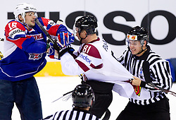 Blaz Gregorc of Slovenia in fight with Georgijs Pujacs of Latvia during ice-hockey match between Slovenia and Latvia of Group G in Relegation Round of IIHF 2011 World Championship Slovakia, on May 5, 2011 in Orange Arena, Bratislava, Slovakia. Slovenia defeated Latvia 5-2. (Photo By Vid Ponikvar / Sportida.com)