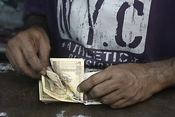 November 9, 2016 - Kolkata, West Bengal, India - A shop owner count Rs.500 banknote as he have to exchange it from bank tomorrow. Business effected all over India as Union Government announcements to one day bank and ATM shut down around the nation due to withdraw of Rs. 500 and Rs. 1000 bank notes nationwide. (Credit Image: © Saikat Paul/Pacific Press via ZUMA Wire)