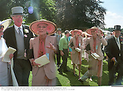 Joe and Nancy Missett meet Nan Kempner in the paddock during Ascot.  © Copyright Photograph by Dafydd Jones<br /> 66 Stockwell Park Rd. London SW9 0DA<br /> Tel 0171 733 0108