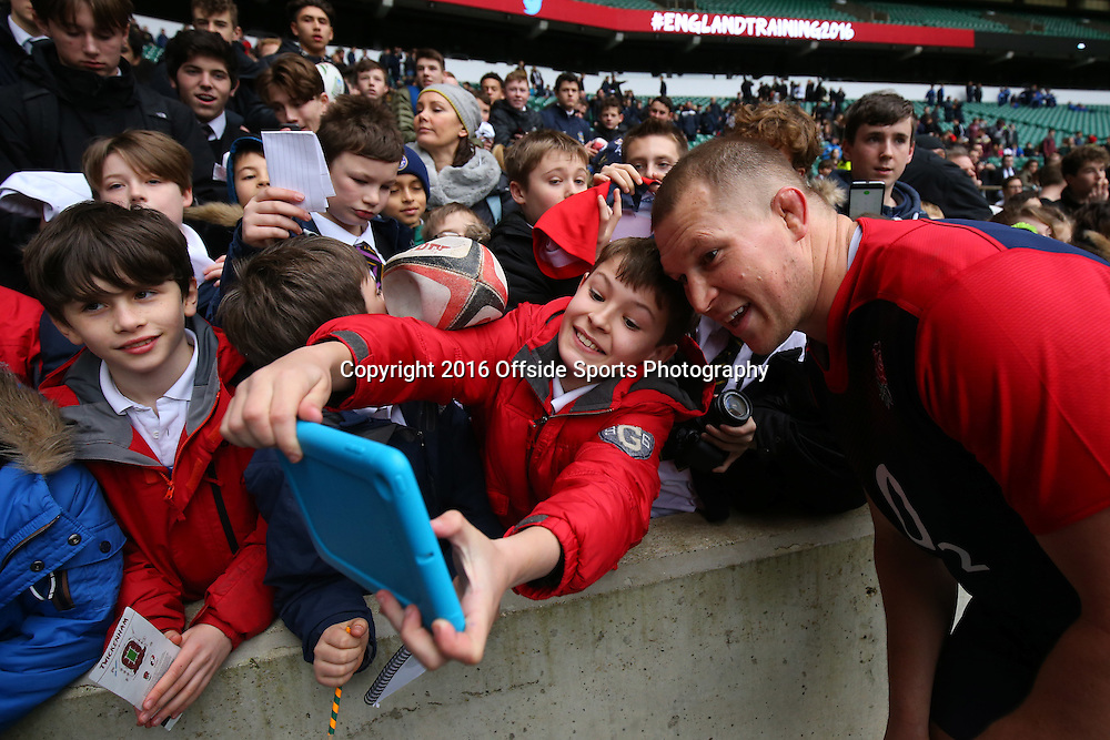 29 January 2016 - England Rugby Open Training Session - England Captain Dylan Hartley poses for a selfie with a fan - Photo: Marc Atkins / Offside.