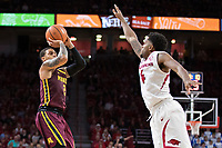 FAYETTEVILLE, AR - DECEMBER 9:  Nate Mason #2 of the Minnesota Golden Gophers shoots a jump shot against Daryl Macon #4 of the Arkansas Razorbacks at Bud Walton Arena on December 9, 2017 in Fayetteville, Arkansas.  The Razorbacks defeated the Golden Gophers 95-79.  (Photo by Wesley Hitt/Getty Images) *** Local Caption *** Nate Mason; Daryl Macon